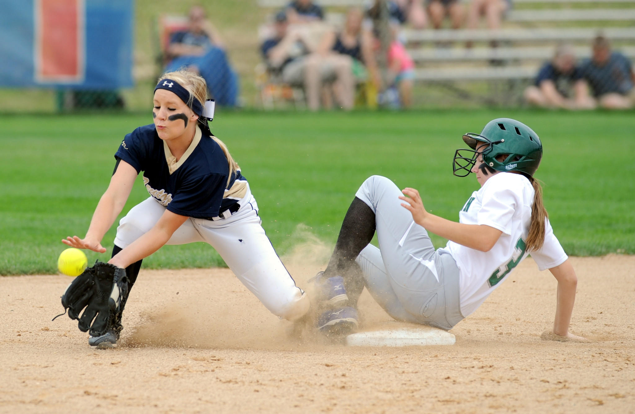 Maris Boelens of Rock Island slides into second as Patricia Campbell takes the late throw.
