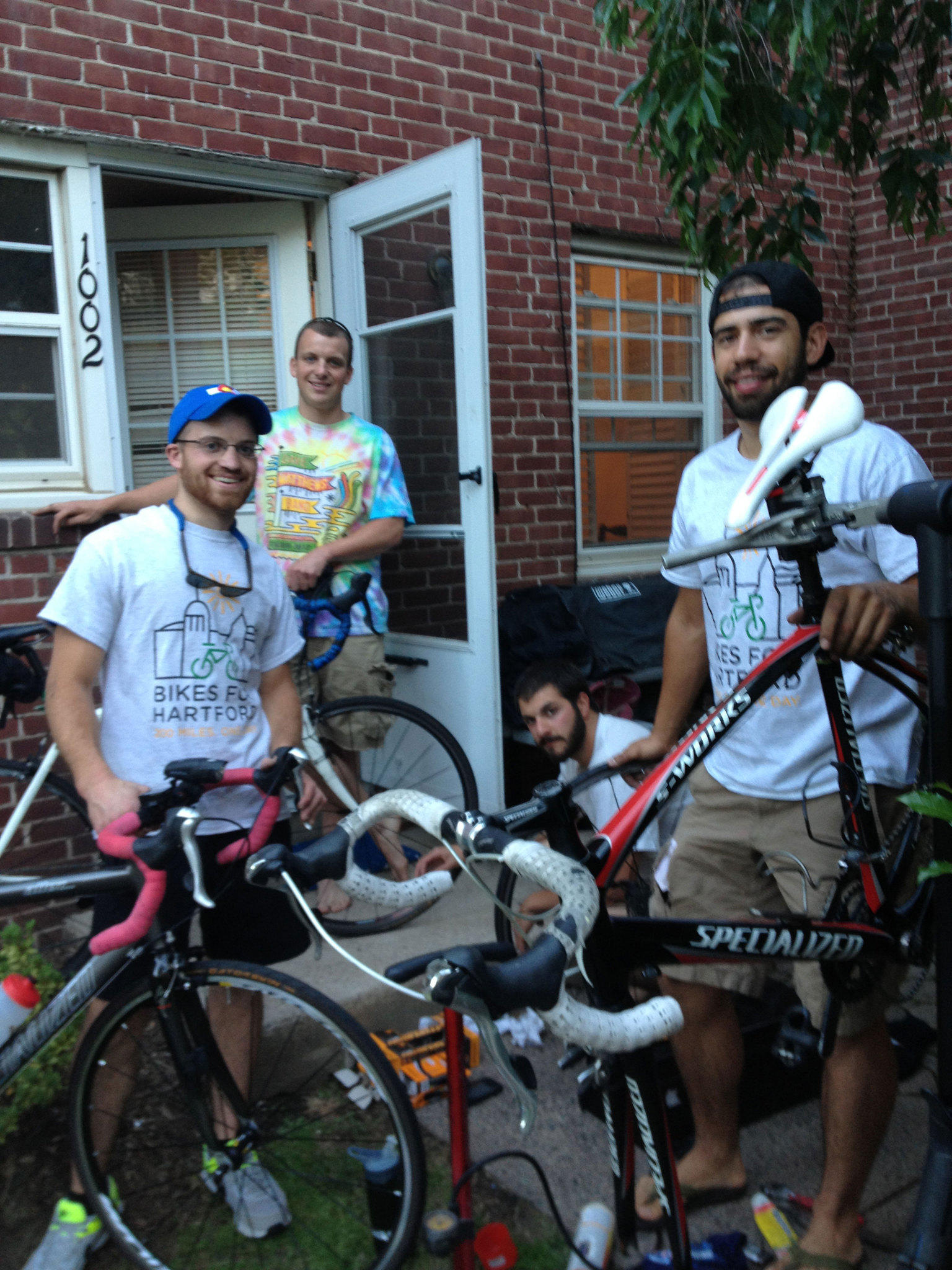 From left, Tim Scully of Unionville, Patrick Scully of Unionville, Nick Fitzner of Glastonbury, Chris Rago of West Hartford. Tim, Patrick and Chris will be biking 200 miles from Provincetown to Hartford on Sunday to raise money for Bikes for Hartford. Nick will be providing support on the trip. Another cyclist, Andy Meigs, will be biking, too. LORI RILEY / HARTFORD COURANT