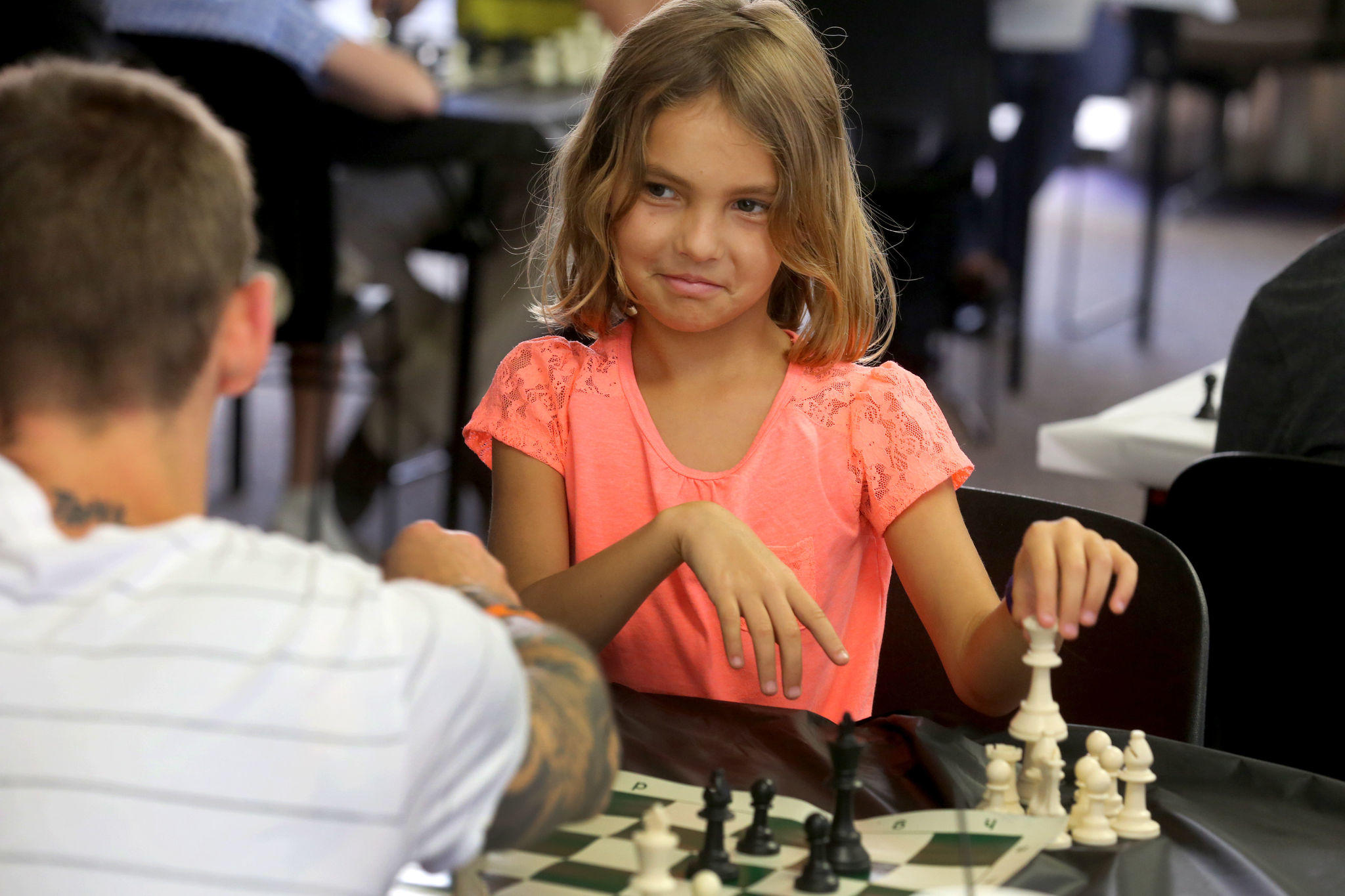 Zachary Bernier and his daughter Kayla, 8, play chess during the Mayors' Chess Challenge at Sunrise City Hall.