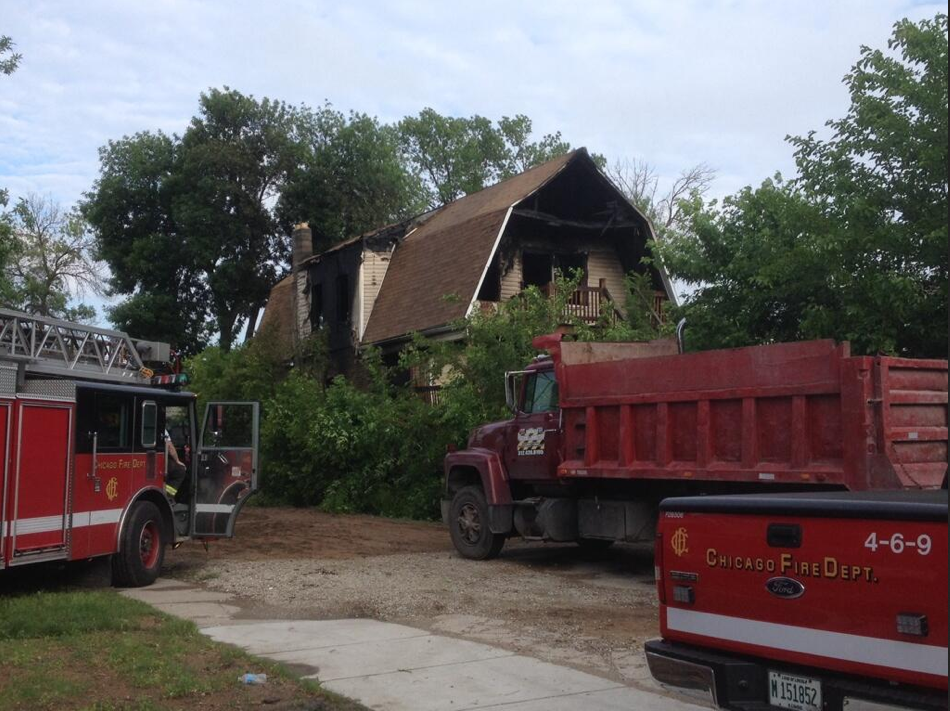 Fire personnel respond to a blaze at a home occupied by squatters on the 900 block of North Lawndale Avenue.