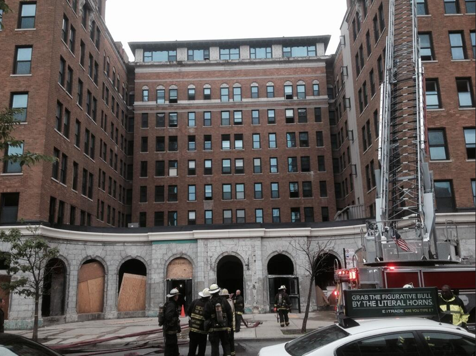 Fire personnel attend a blaze at an empty highrise in uptown.
