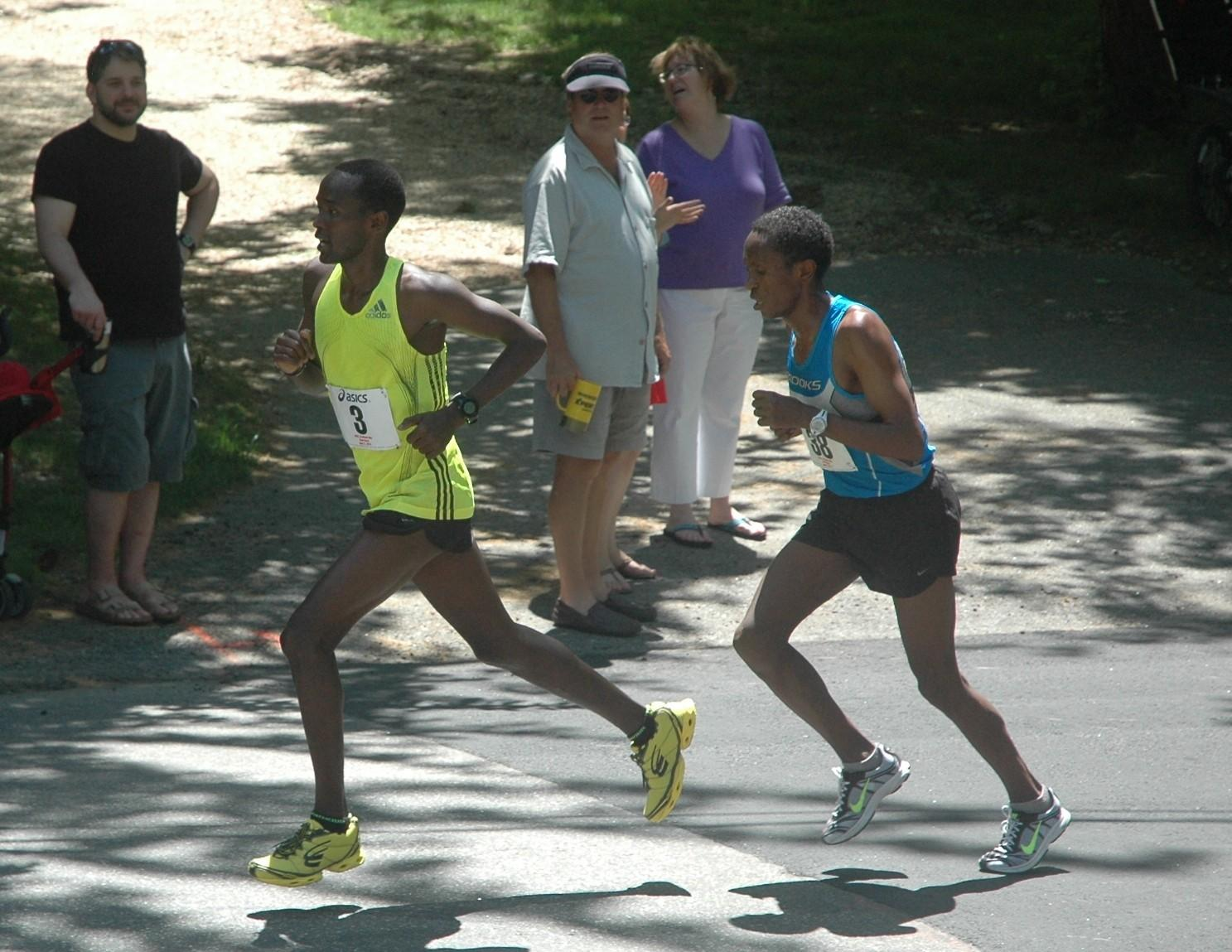 Eliud Ngetich of Kenya stays ahead of Allele Megersa of Ethiopia going up the Gallows Lane hill in the seventh mile of the 7.1-mile Litchfield Hills Road Race Sunday afternoon. Ngetich won in 34:40 and Megersa was second in 34:45.
