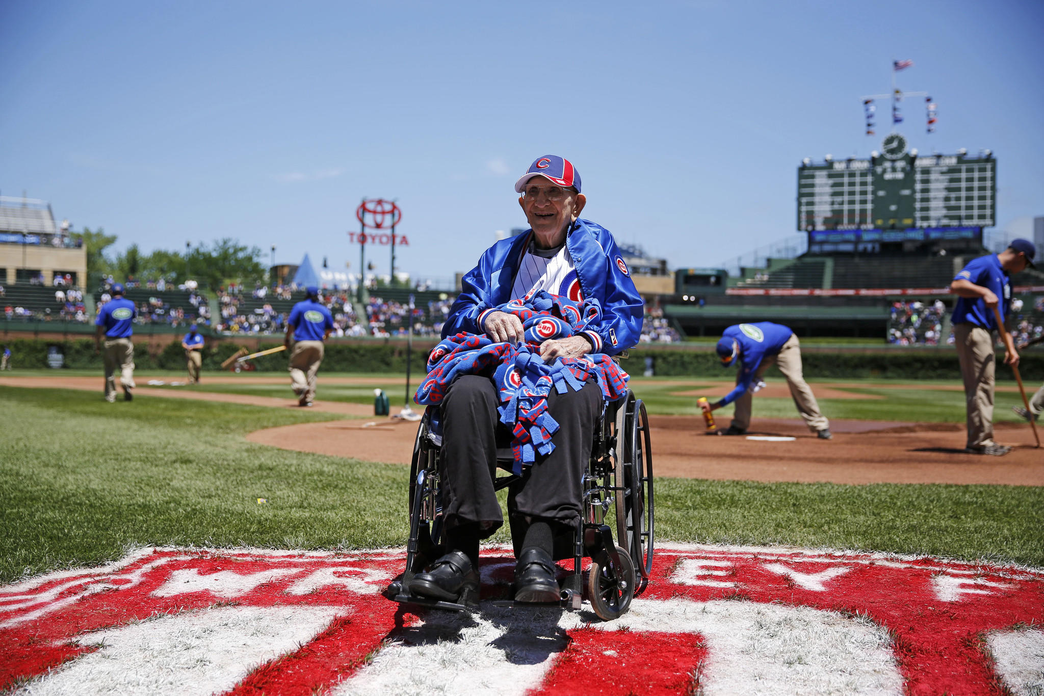 Louis Reinhart, a 100-year-old retired farmer from Metamora, poses for a photograph during pre-game activities.