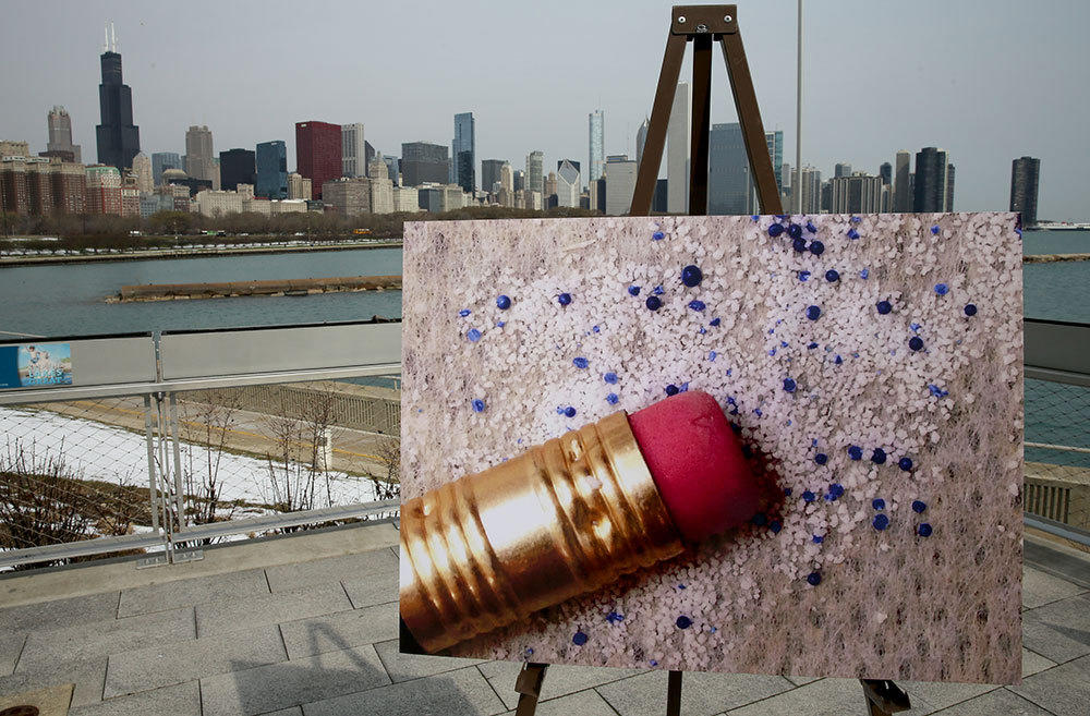 Enlarged photo of tiny synthetic plastic particles called microbeads placed for a press conference outside the Shedd Aquarium on April 16.