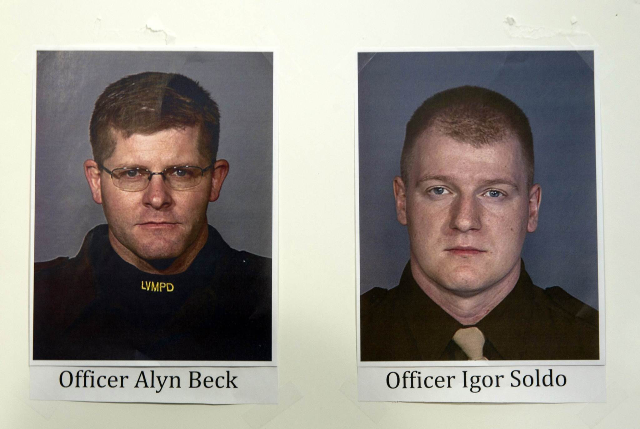 Photos of slain Metro Police officers Alyn Beck and Igor Soldo are displayed during a news conference at Metro headquarters following the death of the two officers and a citizen in Las Vegas.