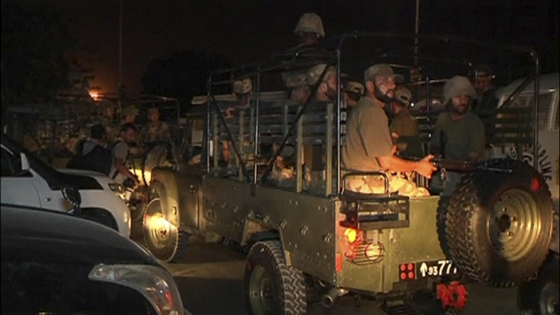 Soldiers sit in a vehicle at Jinnah International Airport in Karachi in this still image taken from video. Gunmen attacked one of Pakistan's biggest airports in Karachi, killing at least five people.