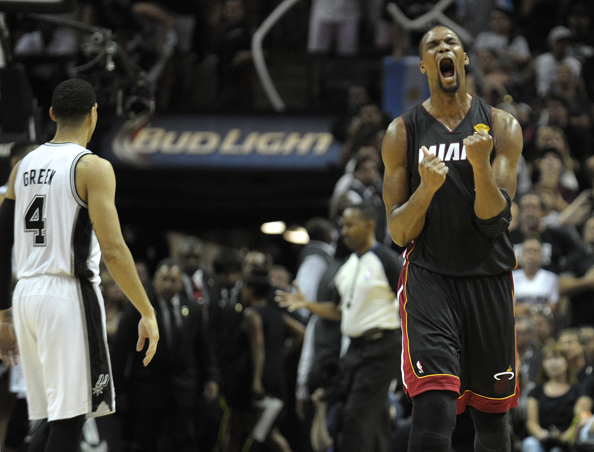 Miami Heat forward Chris Bosh reacts to a Dwyane Wade basket during the final minute of Game 2 of the NBA Finals against the San Antonio Spurs, Sunday, June 8, 2014. Michael Laughlin, South Florida Sun Sentinel