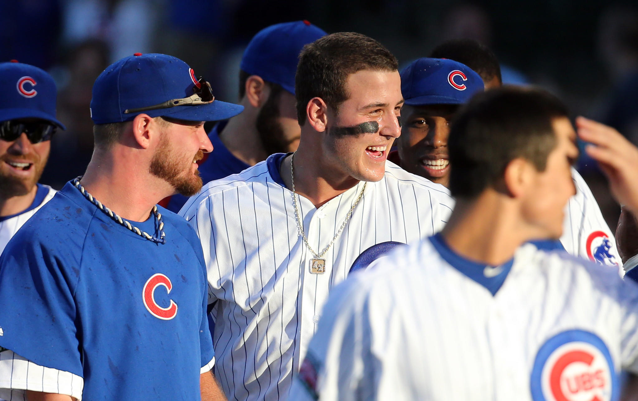 Cubs first baseman Anthony Rizzo celebrates his walk-off home run Friday with teammates.