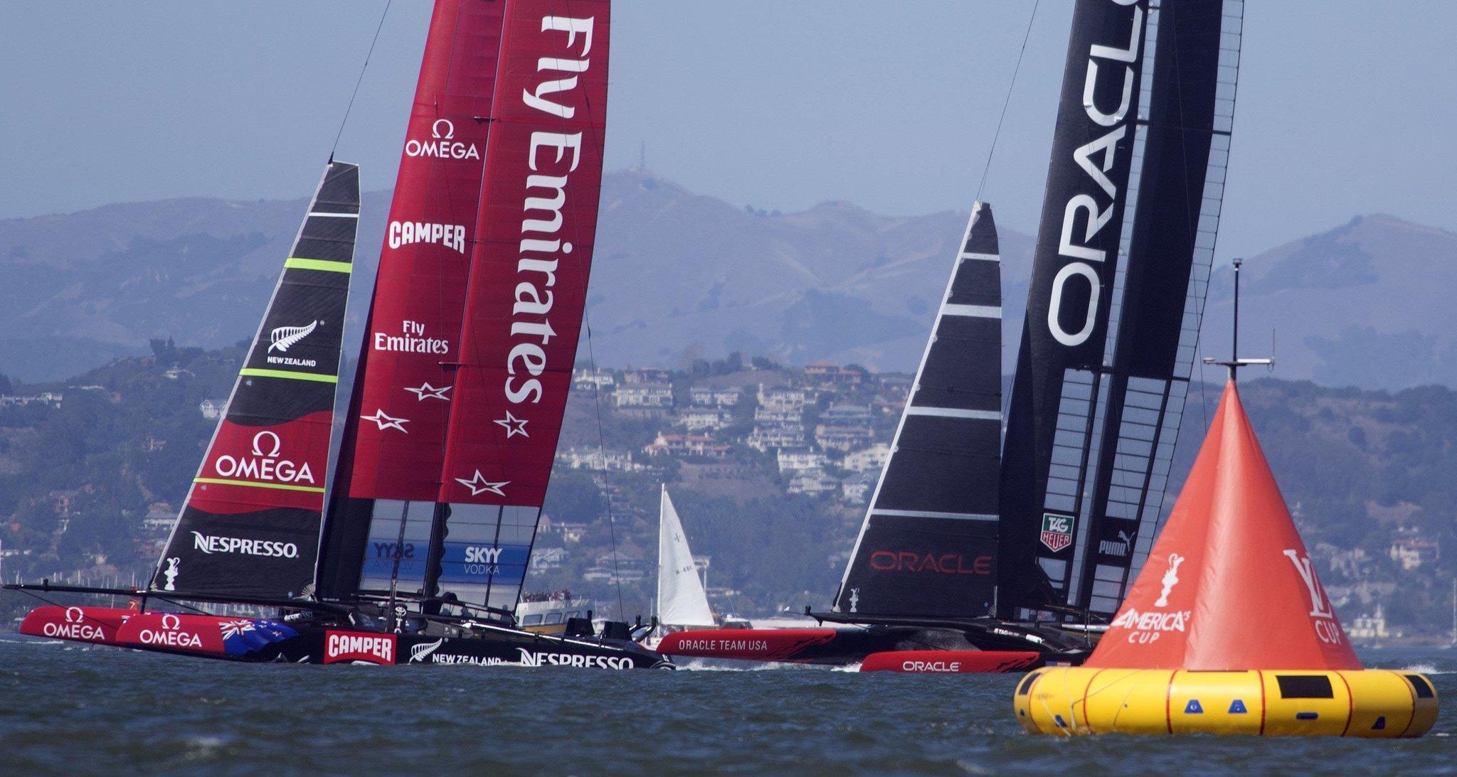 Emirates Team New Zealand, left, and Oracle Team USA vie for position in the starting box during the 17th race of the 34th America's Cup in September 2013 in San Francisco