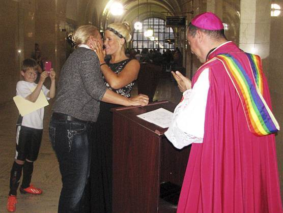 Pamela Norby and Crystal Norby kiss after being married at the Milwaukee County Clerk's office in Milwaukee on June 6.