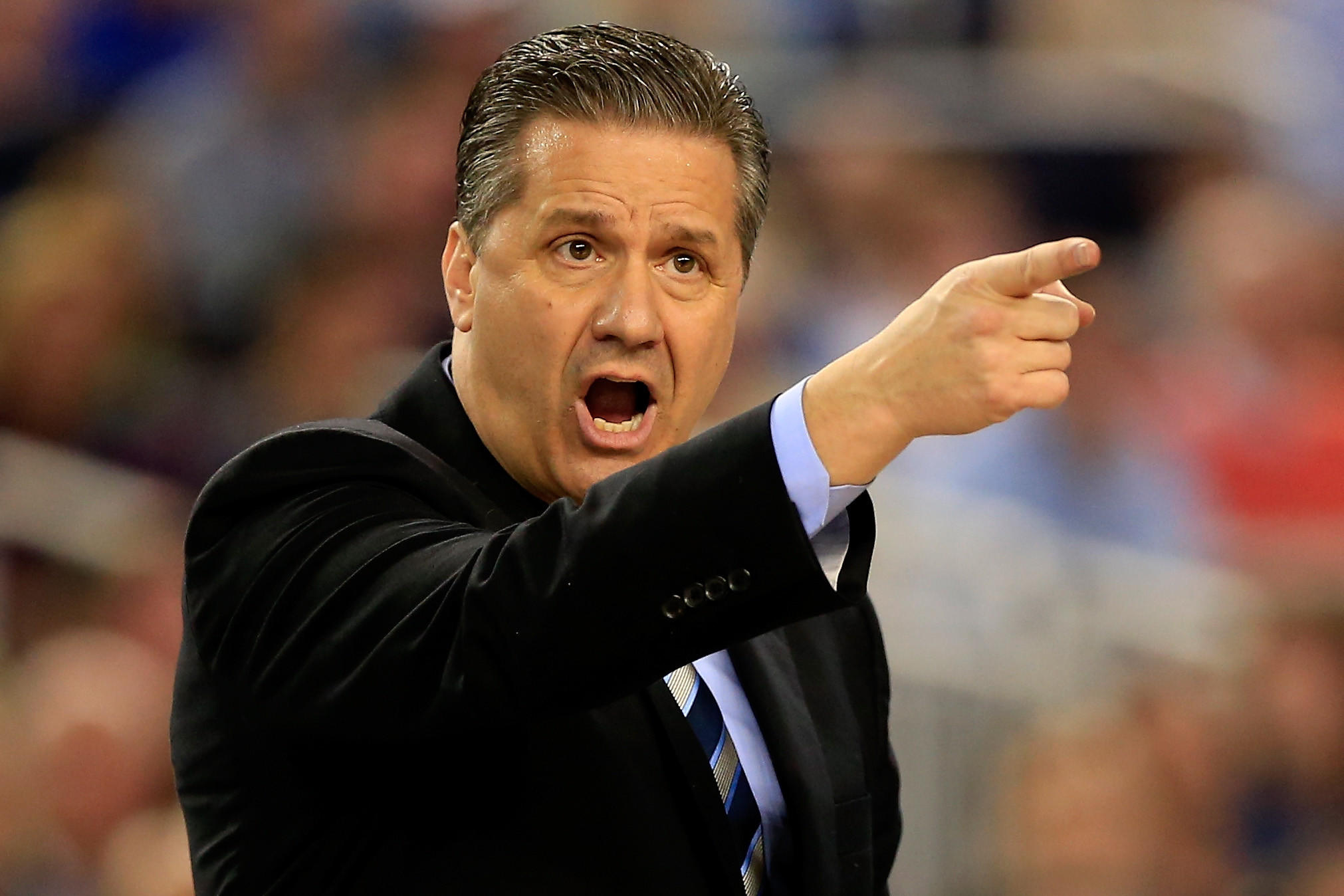 Kentucky head coach John Calipari motions to his players during the NCAA Final Four Championship against the Connecticut Huskies at AT&T Stadium on April 7, 2014.