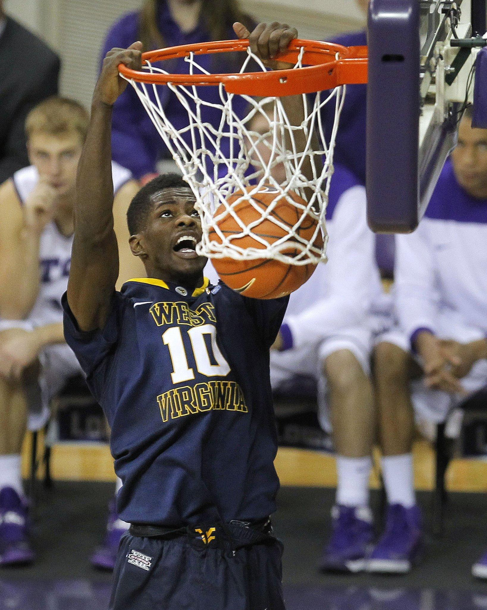 West Virginia guard Eron Harris dunks against Texas Christian in the first half in Fort Worth, Texas, Saturday, Jan. 4, 2013.