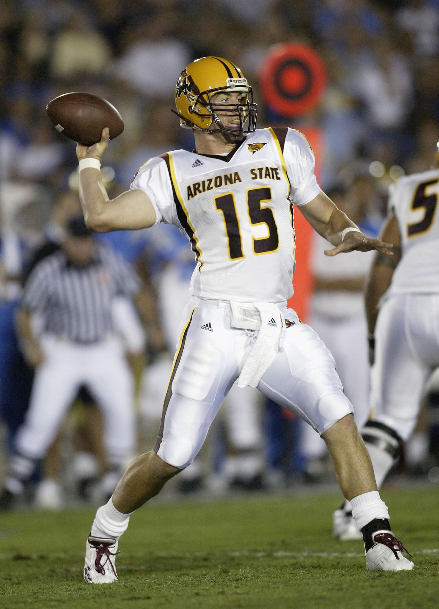 Quarterback Sam Keller of the Arizona State Sun Devils throws a pass against the UCLA Bruins on October 25, 2003.