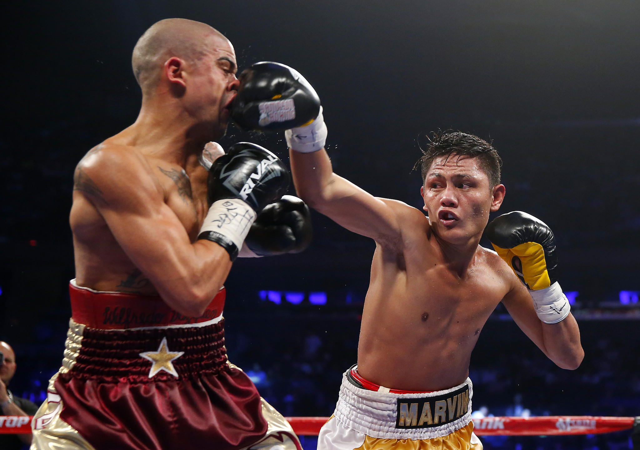 Marvin Sonsona of the Philippines lands a right punch to the face of Wilfredo Vazquez Jr. of Puerto Rico during the seventh round of their NABF Featherweight title fight on June 7, 2014 at Madison Square Garden in New York City.