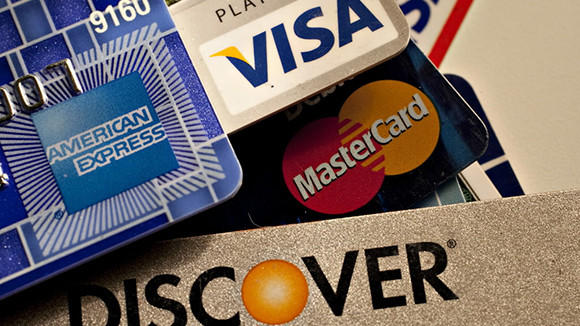 Americans paid off less credit card debt in the first three months of the year, a sign that recession-era financial lessons are beginning to fade.
