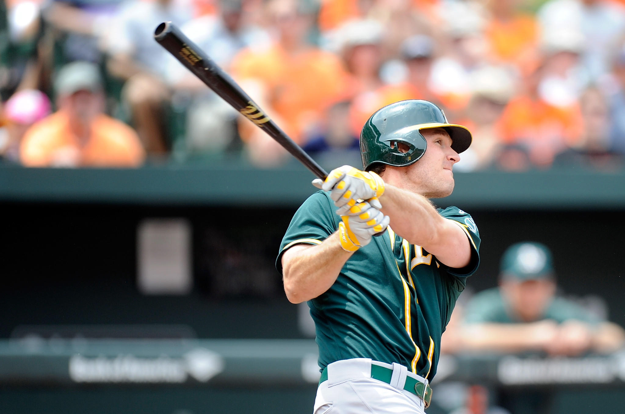 John Jaso of the Oakland Athletics hits a double in the third inning against the Baltimore Orioles at Oriole Park at Camden Yards on June 8, 2014.