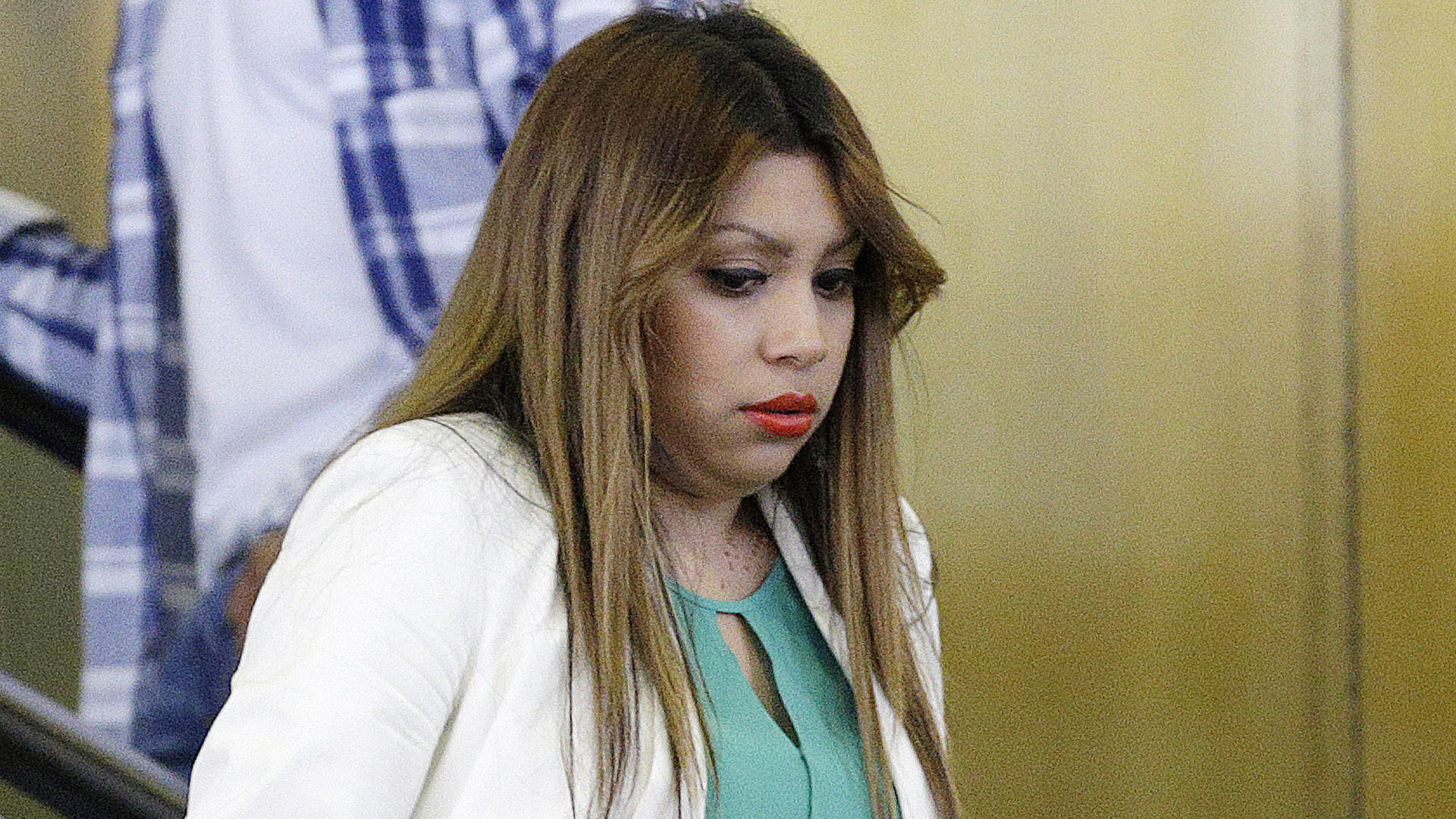 Denisse Ignacio, mother of Eric Galarza Jr., enters court for the murder trial of her son's alleged killer Miguel Hernandez.