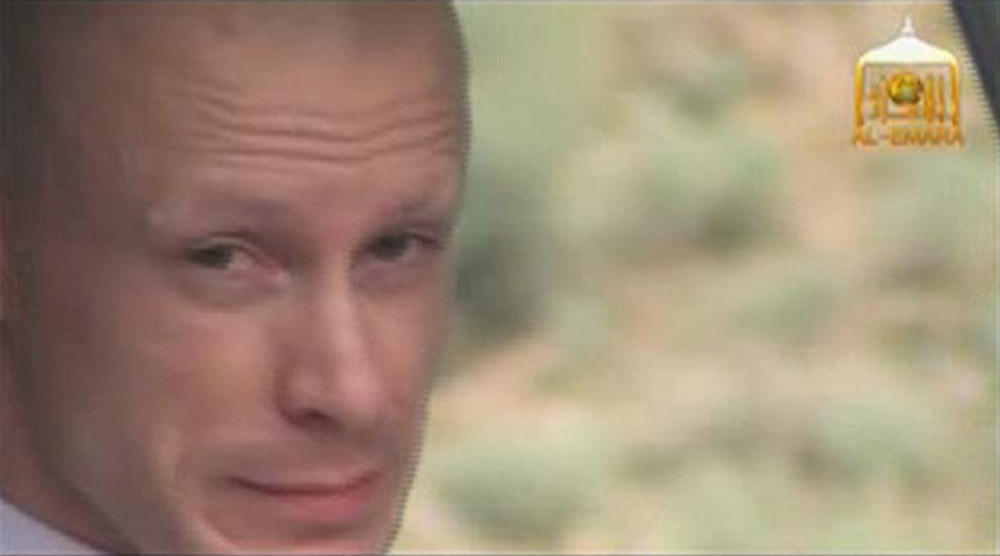U.S. Army Sergeant Bowe Bergdahl waits in a pick-up truck before he is freed at the Afghan border in this still image from a video released June 4.