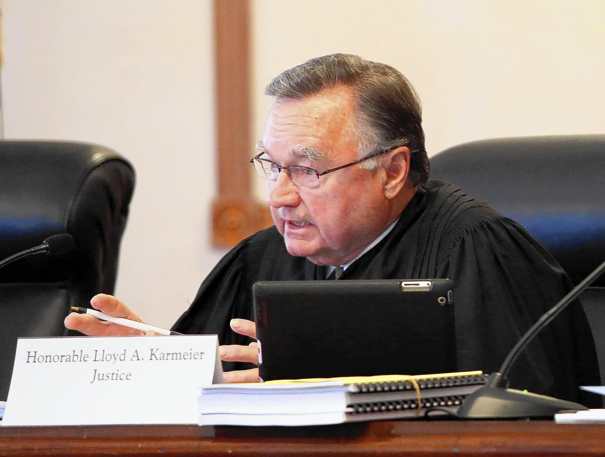 """A lawyer has asked Illinois Supreme Court Justice Lloyd Karmeier to recuse himself from the revived """"light"""" cigarette case because the lawyer alleges that Philip Morris helped get Karmeier elected to the high court in 2004."""