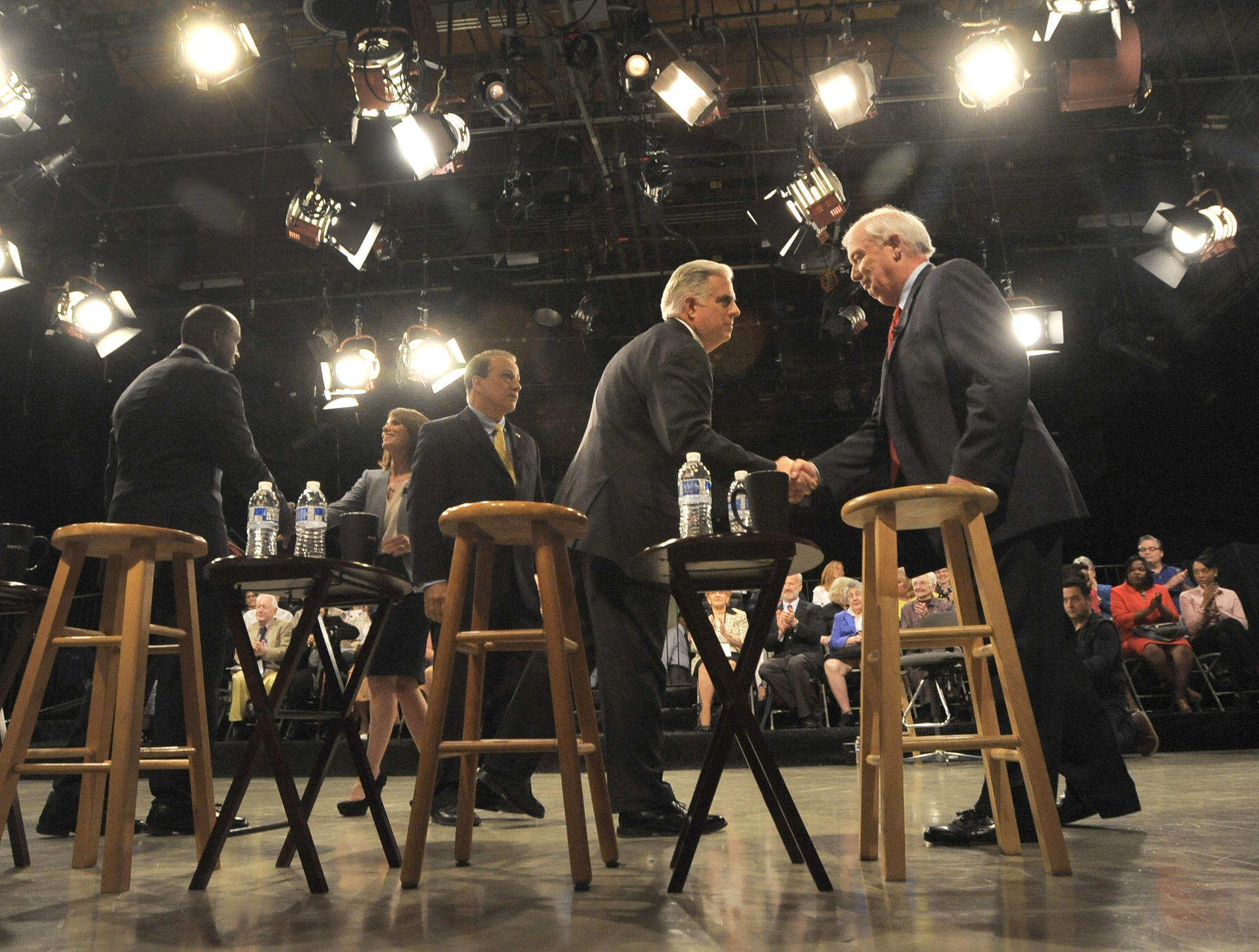 David Craig, right, and Larry Hogan, left, shake hands after their debate.