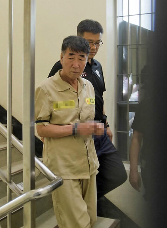 Sewol ferry captain Lee Joon-seok is escorted into court for his trial at the Gwangju District Court in the southwestern South Korean city of Gwangju on June 10.