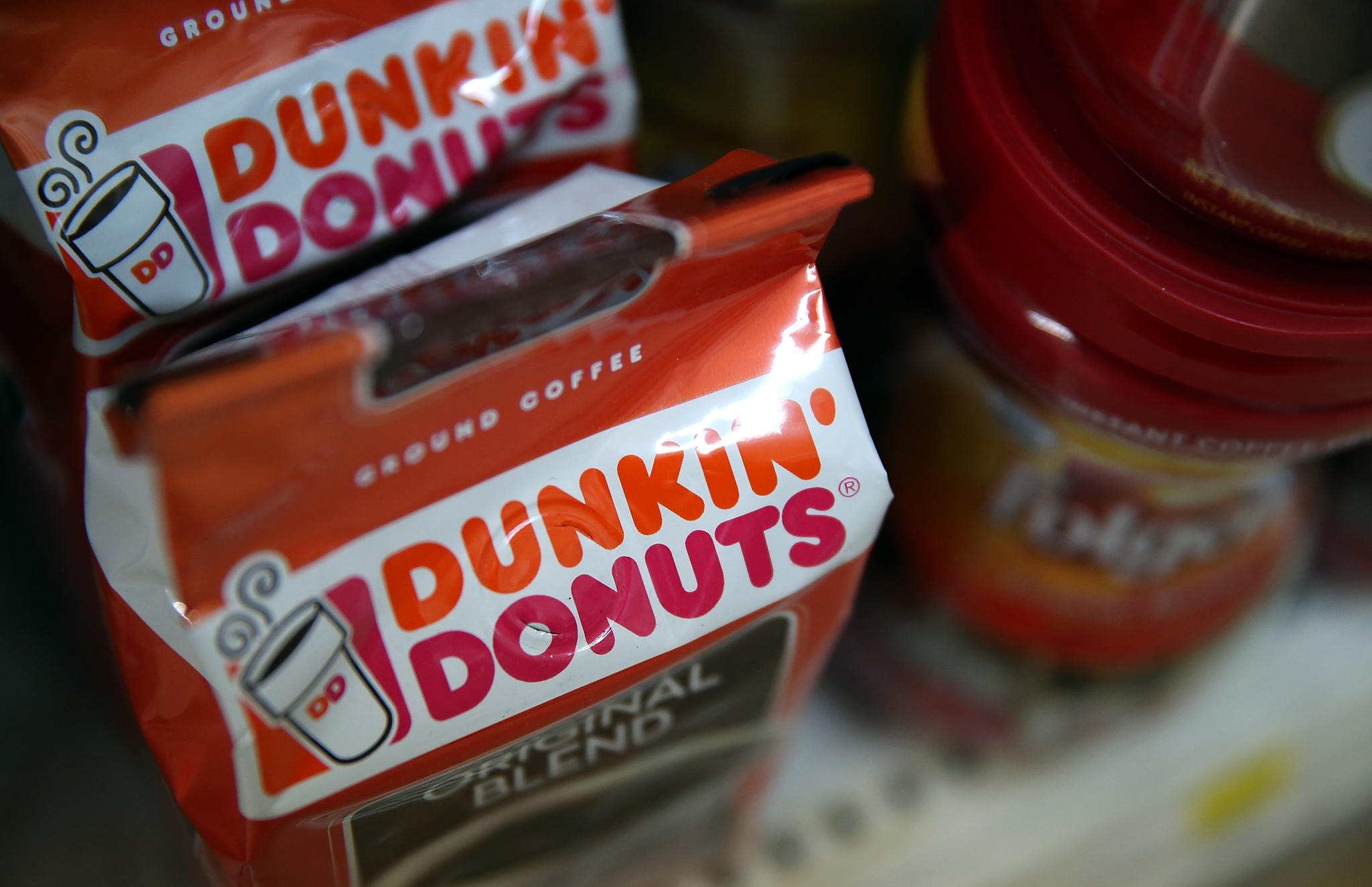 Dunkin' Donuts and Folgers coffee are displayed on a shelf at a grocery store on June 5, 2014 in San Rafael, California.