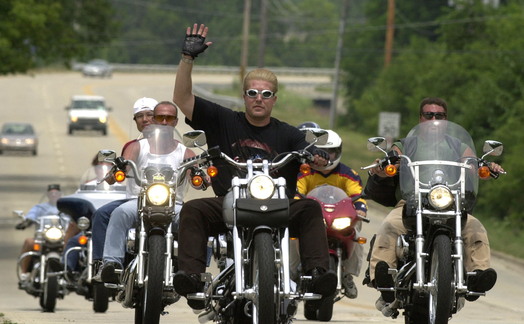 """The American Gold Wing Association Illinois Chapter """"H"""" holds a poker run called """"Christmas in July"""" to benefit several needy groups and people in 2001."""