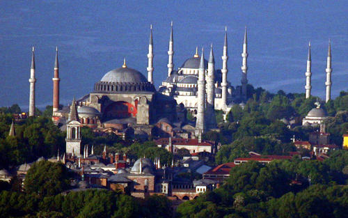 The sixth century Byzantinian monument of St. Sofia (Ayasofya) and the 16th century Ottoman era Blue Mosque are seen behind the Topkapi Palace where the Ottoman sultans once dominated the empire for nearly 400 years in the old city of Istanbul May 15, 2005.
