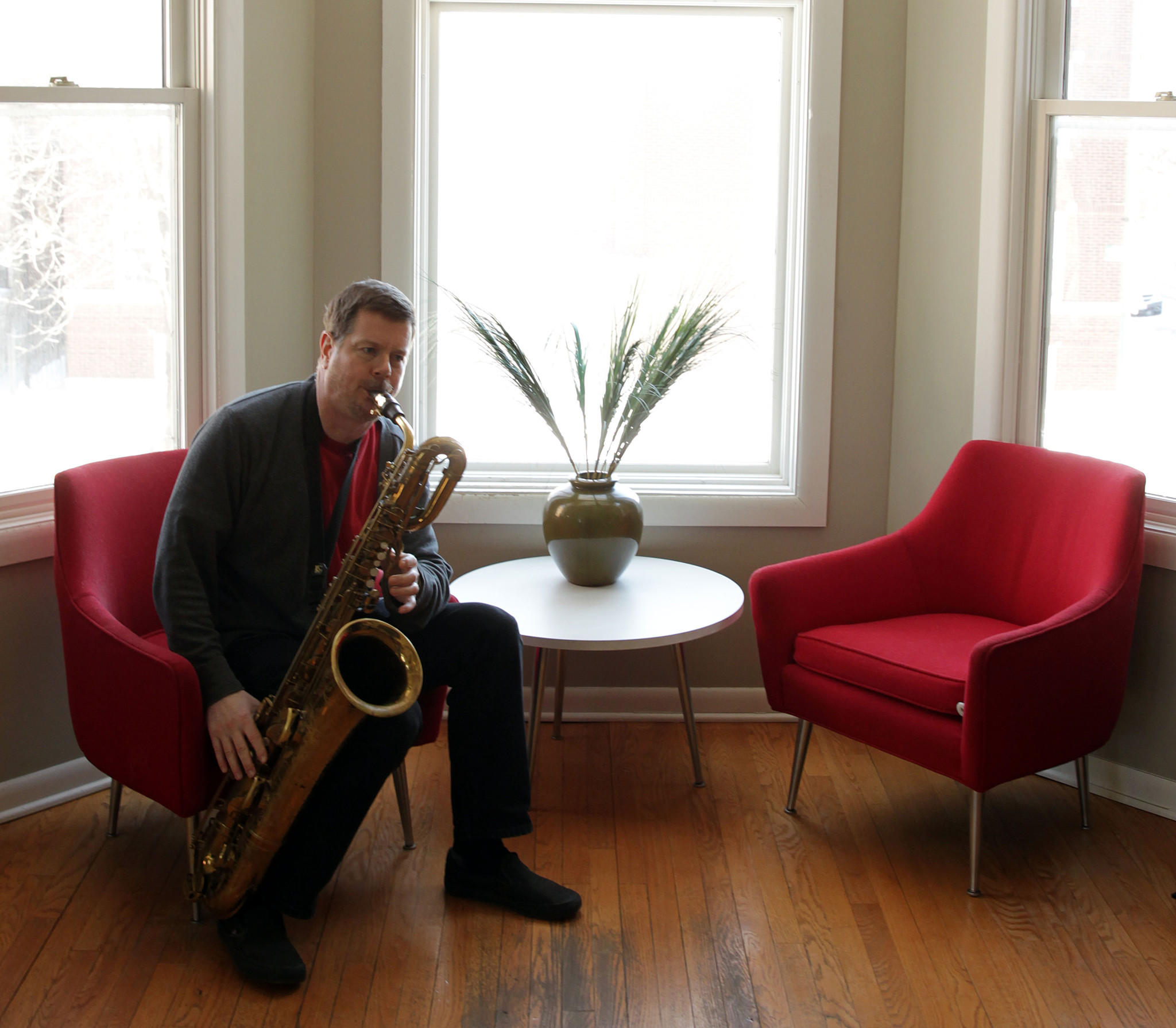Chicago jazz saxophonist-clarinetist and MacArthur Fellowship winner Ken Vandermark (with baritone sax) at his north side home/ studio.