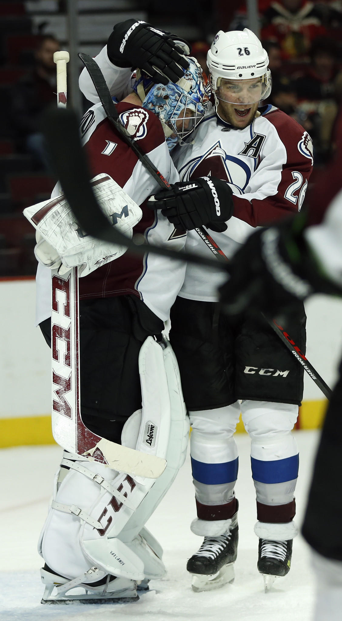 The Avalanche's Paul Stastny (right) and goalie Semyon Varlamov celebrate a 4-2 win over the Blackhawks.