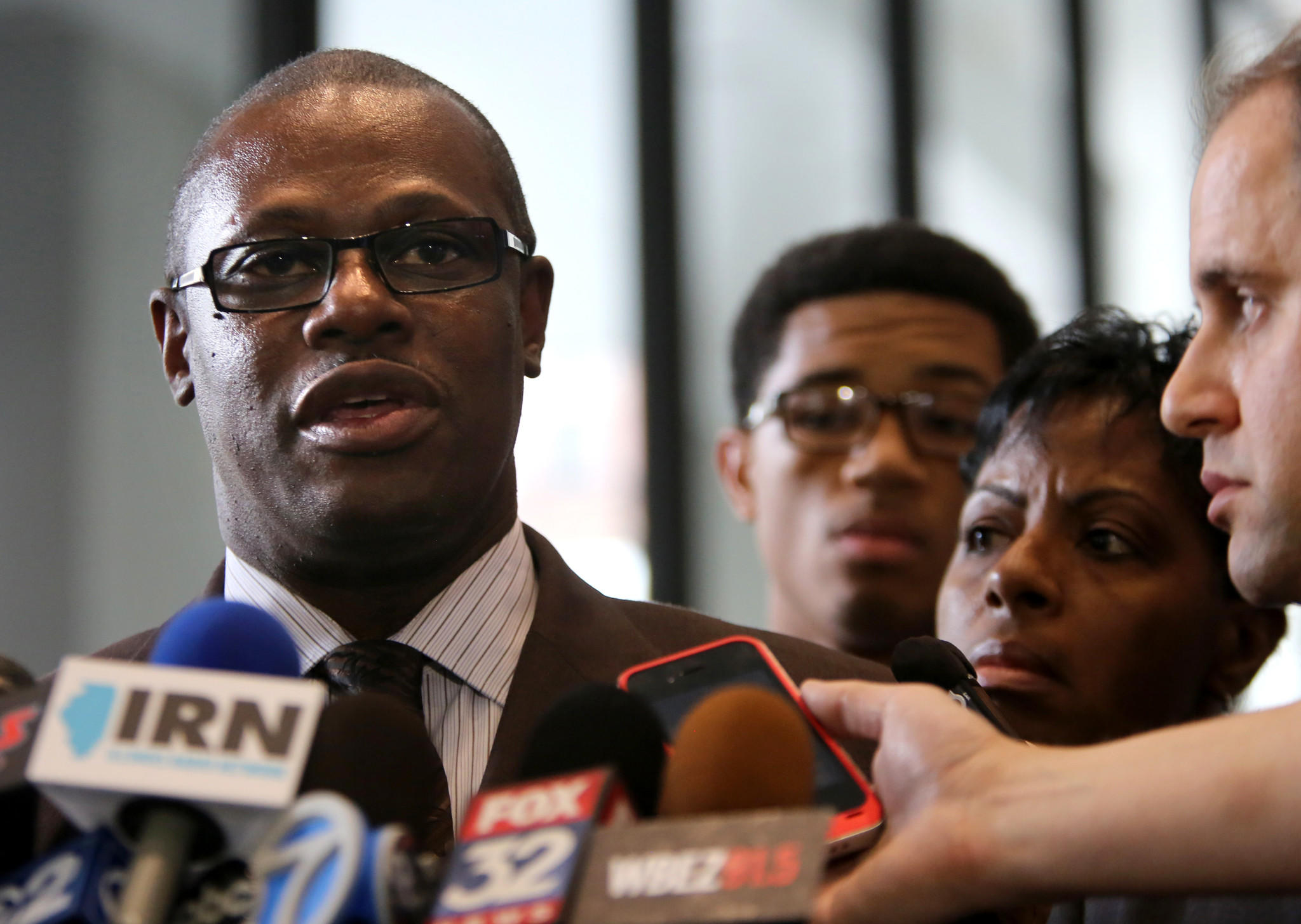 State Rep. Derrick Smith speaks to reporters in the Dirksen U.S. Courthouse following his conviction for pocketing $7,000 in a cash bribe in the days before he won the Democratic primary in 2012.