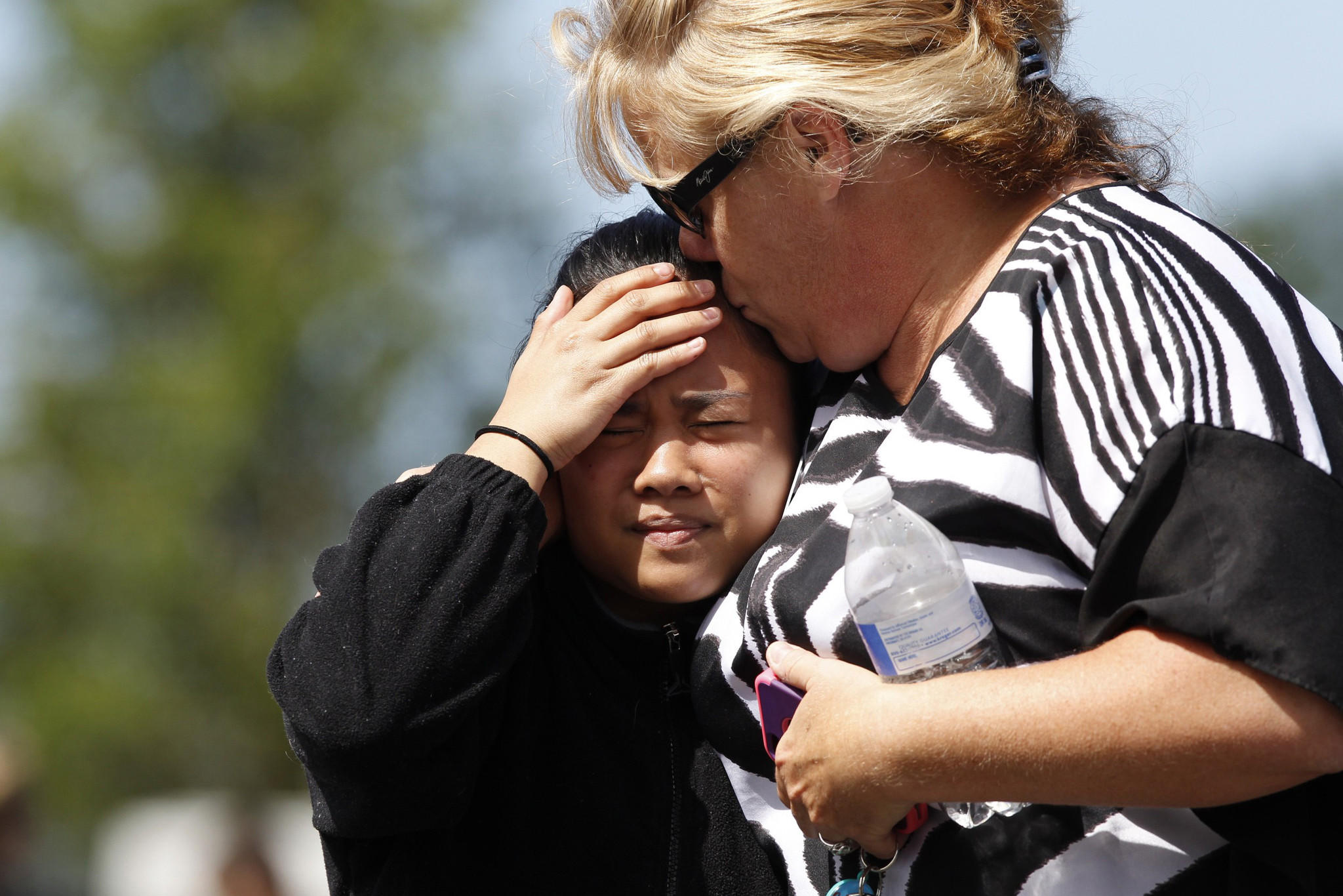Parents and students are reunited after a shooting at Reynolds High School in Troutdale, Oregon.