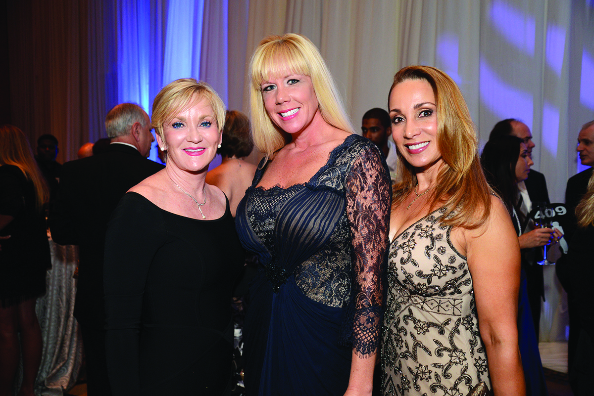"Society Scene photos - Alissa Stefanacci, left, Jen Klaassens and Sandra Mayor came out to show why Philanthropy Rocks at the second annual ""Salah Foundation Broward Health Ball"" presented by One Beat CPR + AED May 3. The event raised more than $850,000 for patient programs and services at all Broward Health hospitals."
