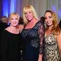 "Alissa Stefanacci, left, Jen Klaassens and Sandra Mayor came out to show why Philanthropy Rocks at the second annual ""Salah Foundation Broward Health Ball"" presented by One Beat CPR + AED May 3. The event raised more than $850,000 for patient programs and services at all Broward Health hospitals."