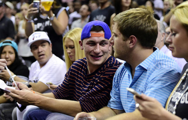 Jun 8, 2014; San Antonio, TX, USA; Cleveland Browns quarterback Johnny Manziel sit court side in game two of the 2014 NBA Finals between the San Antonio Spurs and the Miami Heat at AT&T Center.