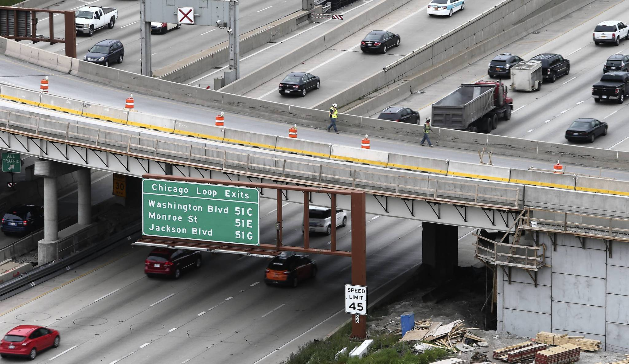 Workers walk on the part of the Ohio-Ontario interchange bridge planned for demolition, just southeast of the Ogden overpass. June 7-8 will be the first of three weekends that traffic will be dramatically impacted on the Kennedy expressway due to the demolition.
