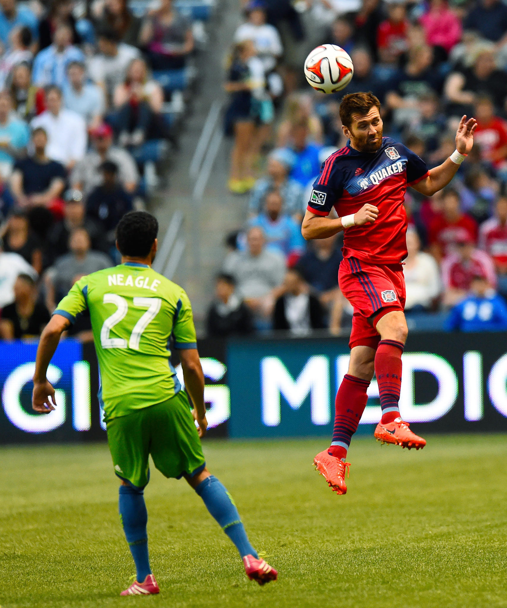 Fire defender Gonzalo Segares heads the ball against Seattle Sounders FC midfielder Lamar Neagle during the first half at Toyota Park.