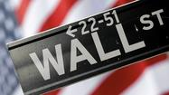 Wall Street ends near flat; deal news offsets data