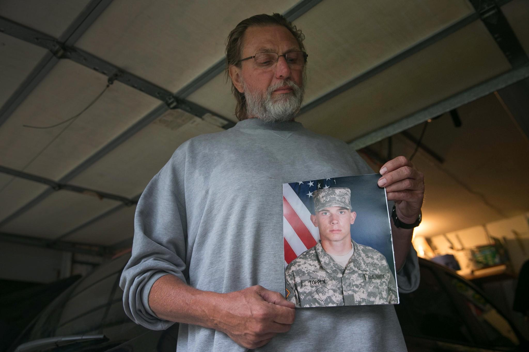 Jack Winter holds a picture of his nephew, U.S. Army soldier Aaron Toppen, 19, at the family home in Mokena, Illinois. Toppen was killed by friendly fire in Afghanistan.