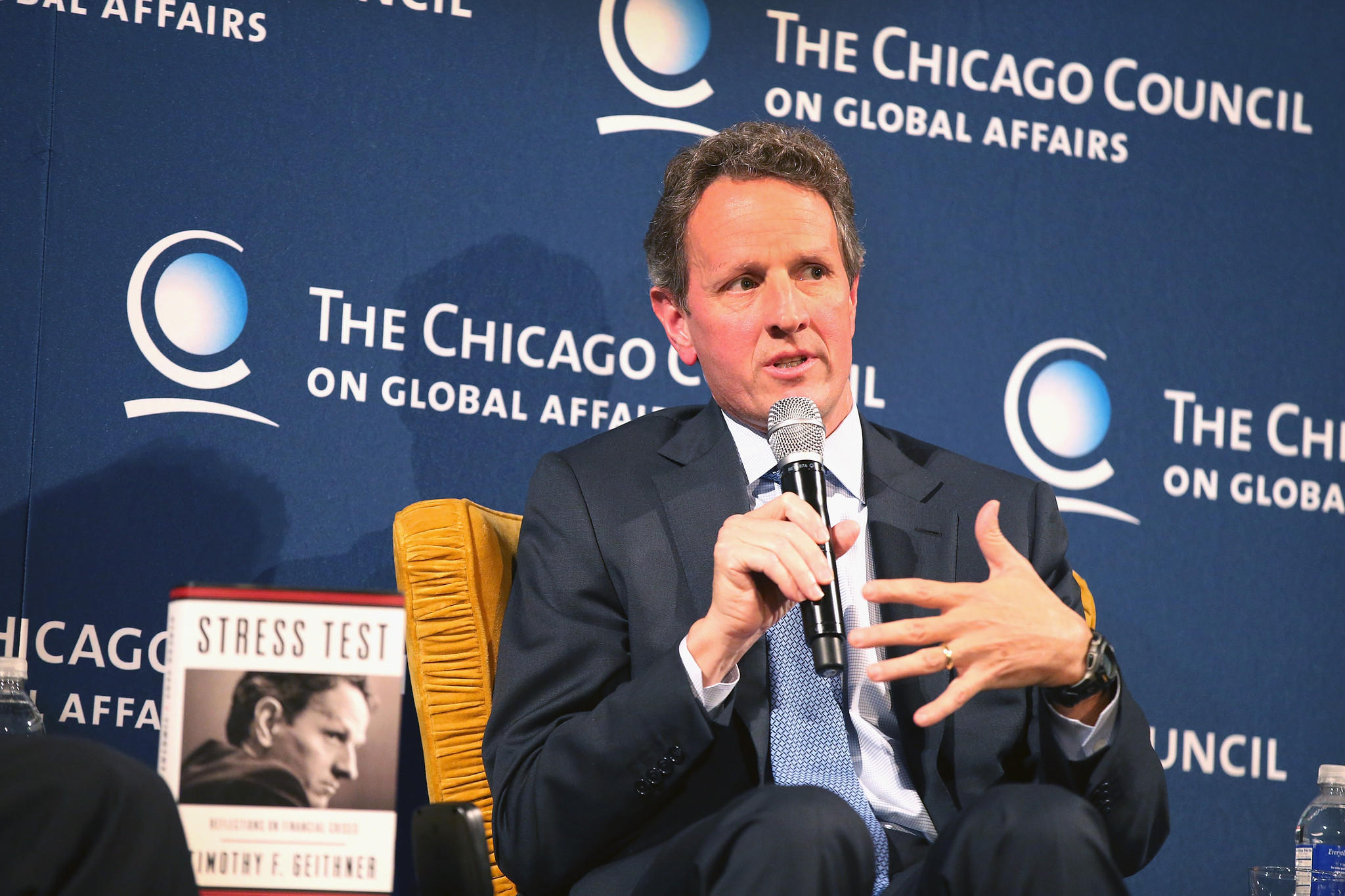 Former U.S. Treasury Secretary Timothy Geithner is interviewed by former U.S. Treasury Secretary Henry Paulson (not pictured) during an event sponsored by Chicago Council on Global Affairs in Chicago.