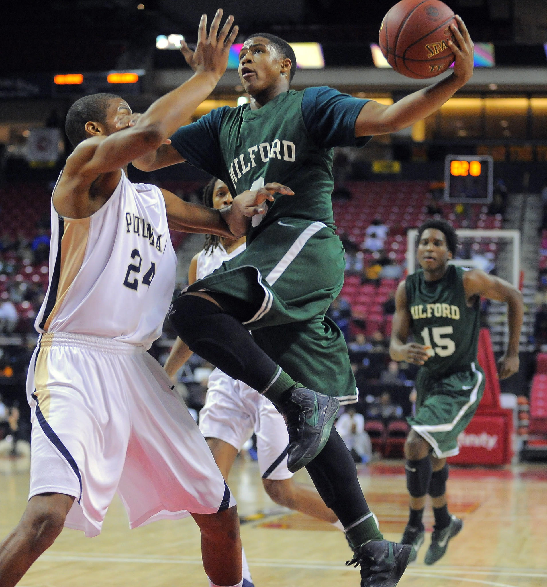 Milford Mill guard Justin Jenifer is fouled by Potomac forward Anthony Smith in the 2013 Class 3A championship game won by the Millers, 84-55.