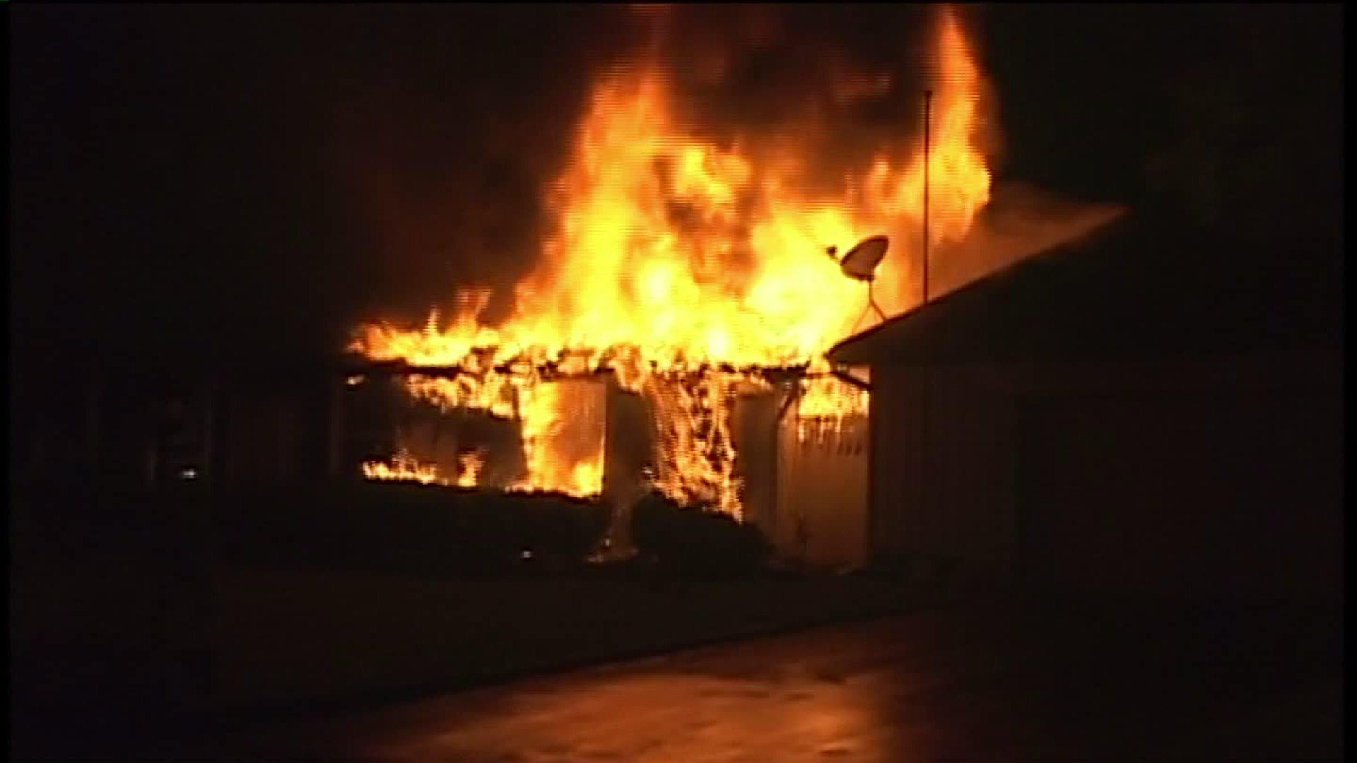 Flames rise from a burning home in southwest suburban Mokena early Wednesday.