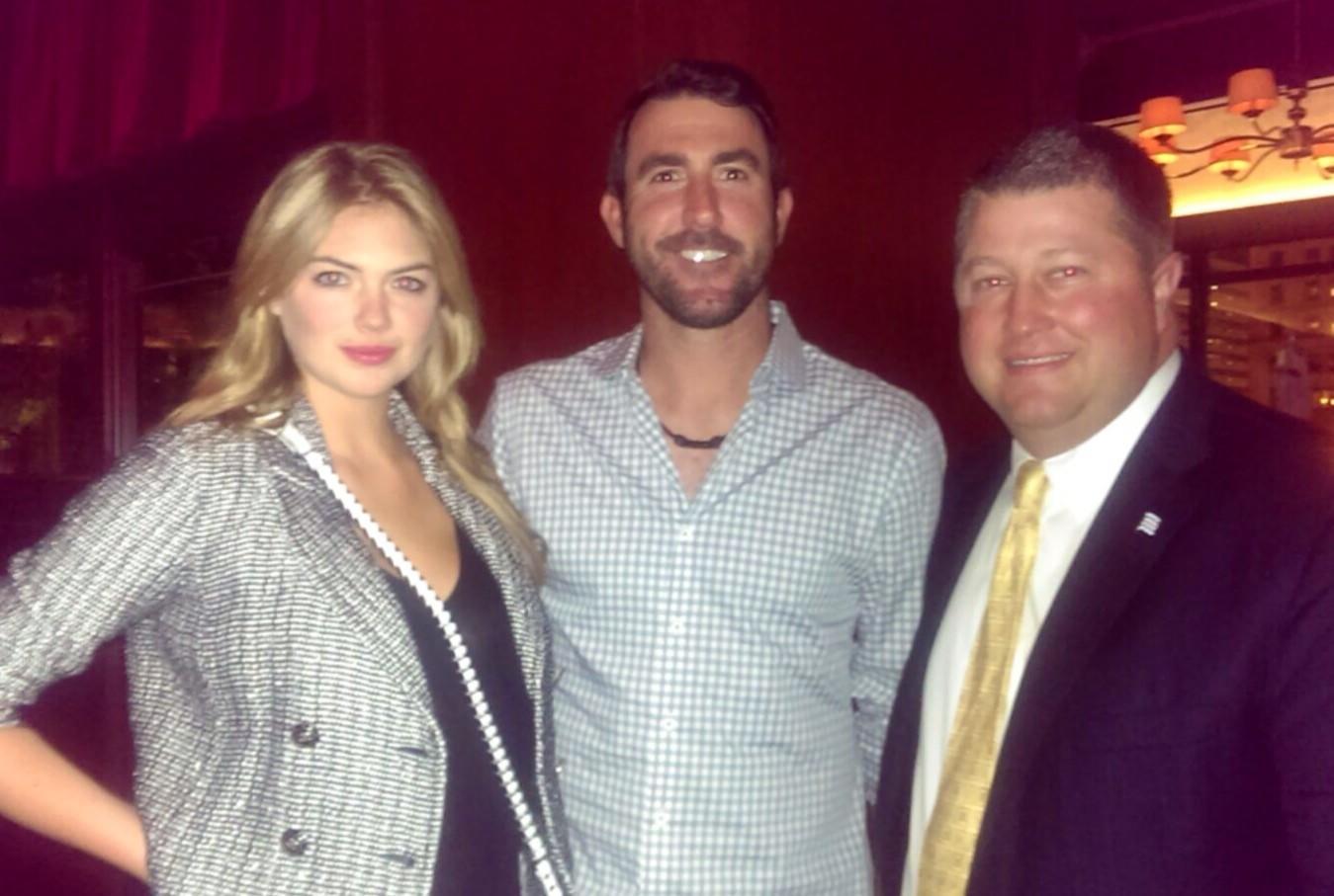 Model Kate Upton (left) and the Detroit Tigers' Justin Verlander (center) at Chicago Cut Steakhouse June 10, 2014 with Chicago Cut managing partner David Flom (right).