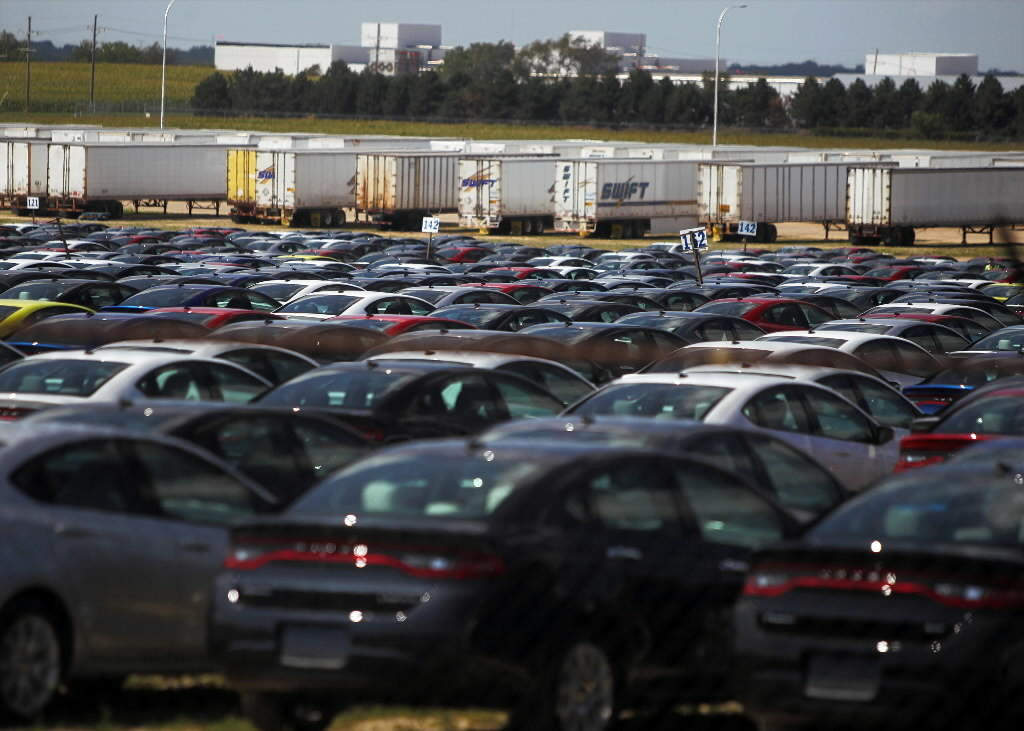 A lot full of cars made by Chrysler fill the lot across from the car company's assembly plant in Belvidere.