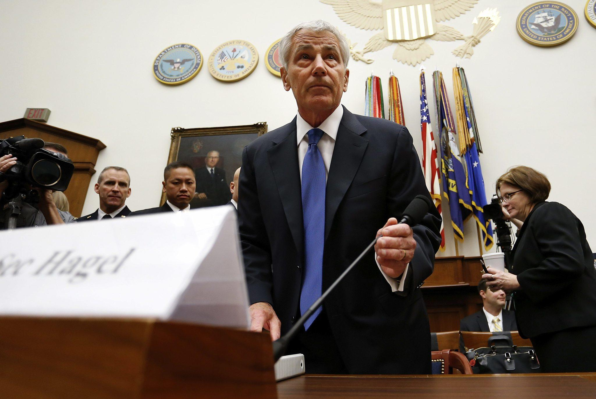 U.S. Defense Secretary Chuck Hagel takes his seat to testify about the Bergdahl prisoner exchange, at a House Armed Services Committee hearing on Capitol Hill in Washington June 11, 2014.