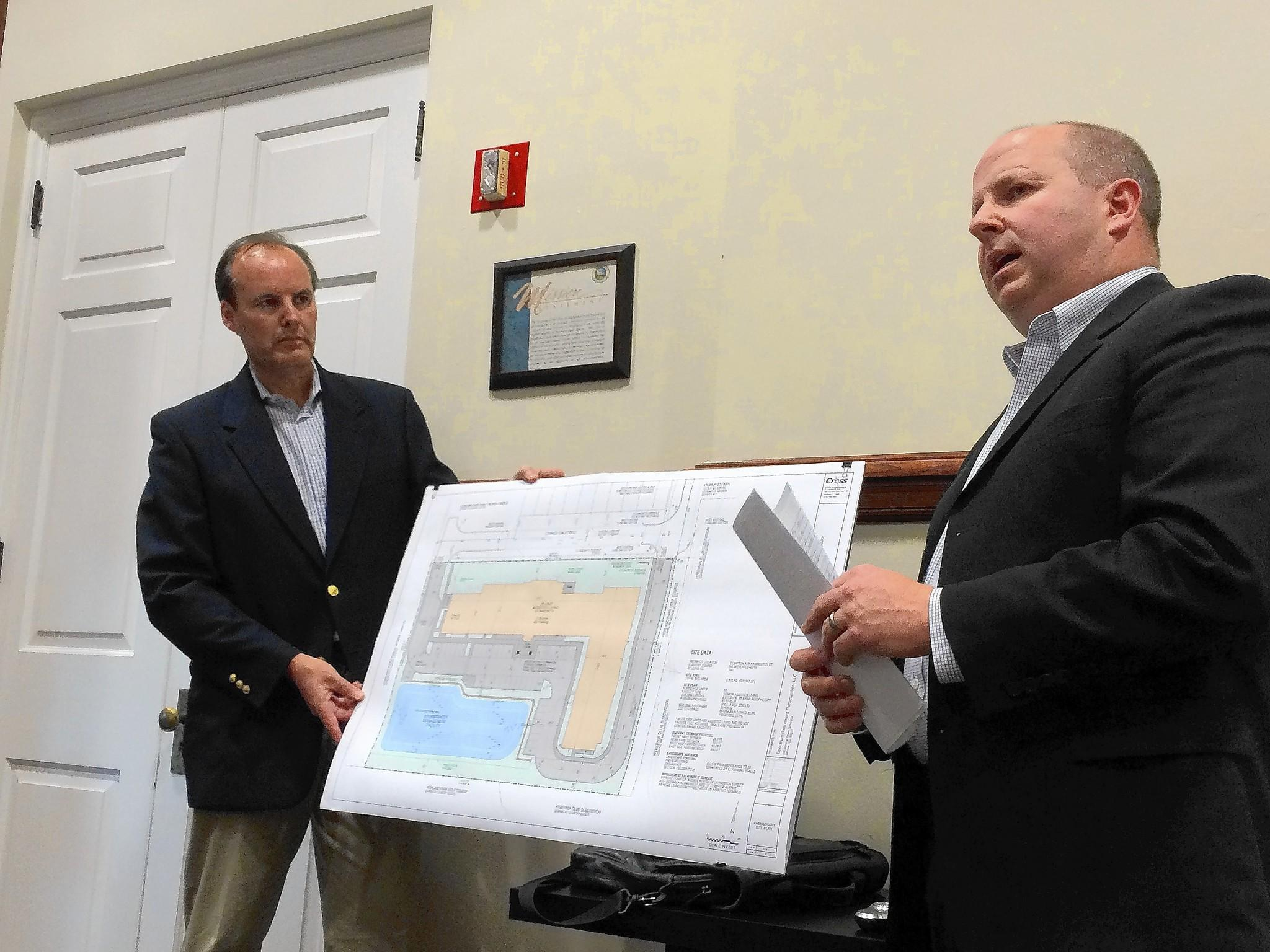 Mike Longfellow, at left, vice president of development and construction for Spectrum Retirement Communities, and project engineer Stephen Cross present a smaller-scale proposal for a senior living facility in Highland Park than the Spectrum plan rejected back in March.