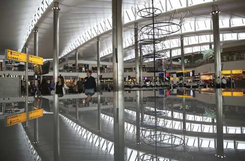 A view of the departure lounge is reflected in Terminal 2 at Heathrow Airport in London June 4, 2014.