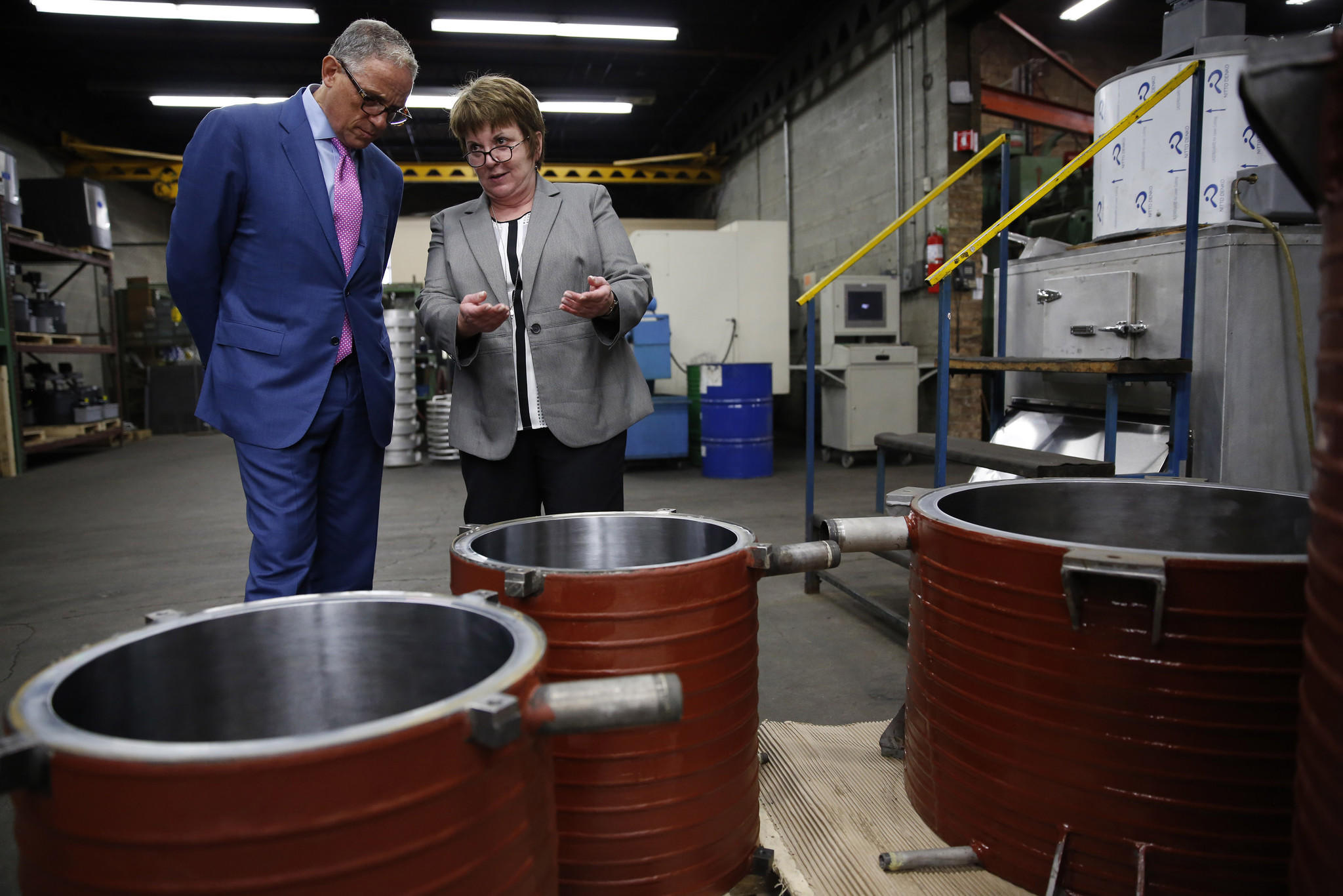Fred Hochberg, left, Chairman and President of the Export-Import Bank of the United States, chats with Mary Howe, President of Howe Corporation, who is giving a tour of the manufacturing facility of Howe Corporation located at 1650 N. Elston Ave. in Chicago and talking about the evaporators for the refrigerant units made at the facility seen here on Wednesday, June 11, 2014. Howe Corporation is a 4th-generation family-owned Chicago small business that exports refrigeration equipment with the support of Ex-Im Bank.