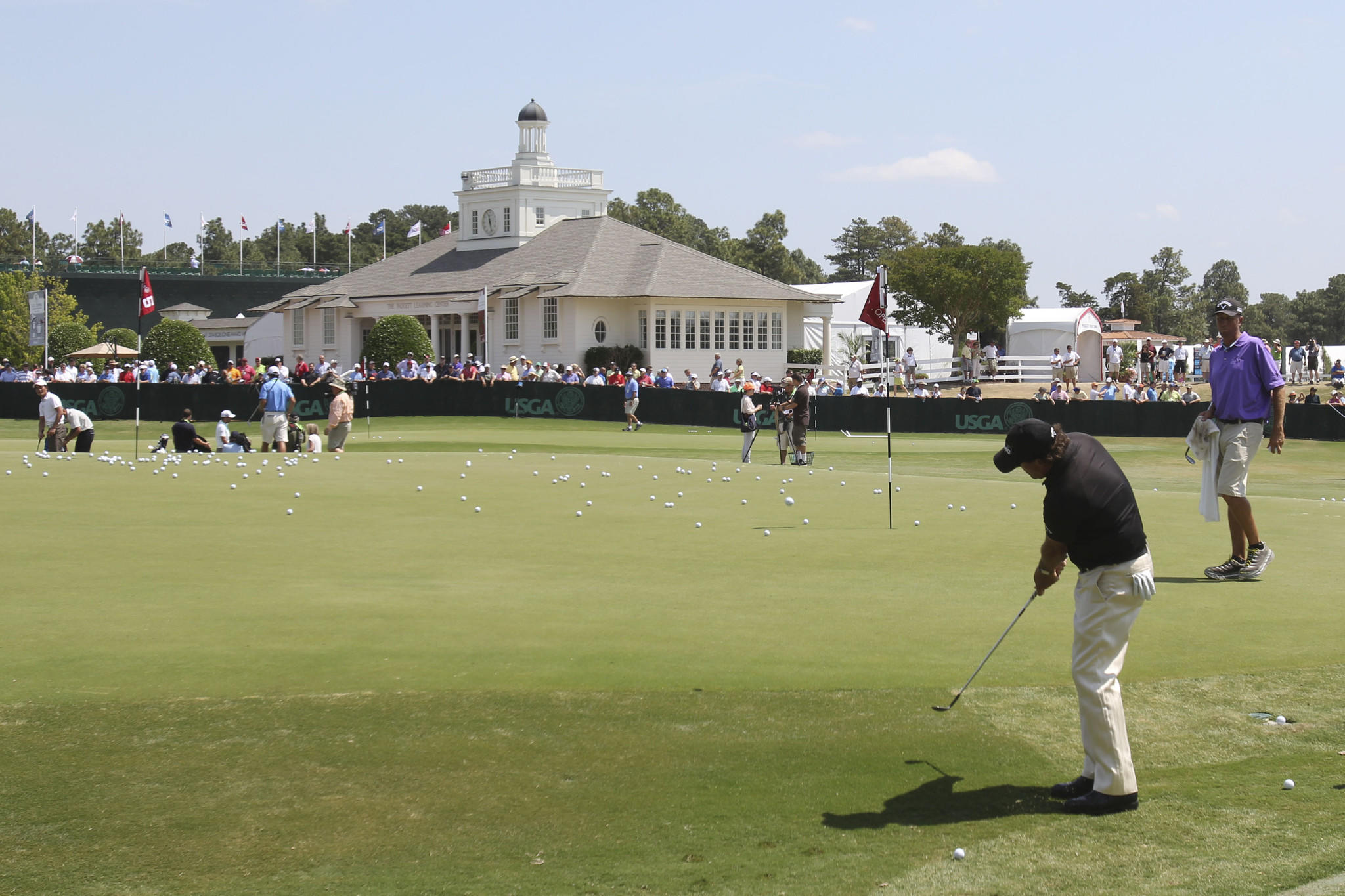 Phil Mickelson chips on the practice green during a practice round for the U.S. Open golf tournament at Pinehurst No. 2.