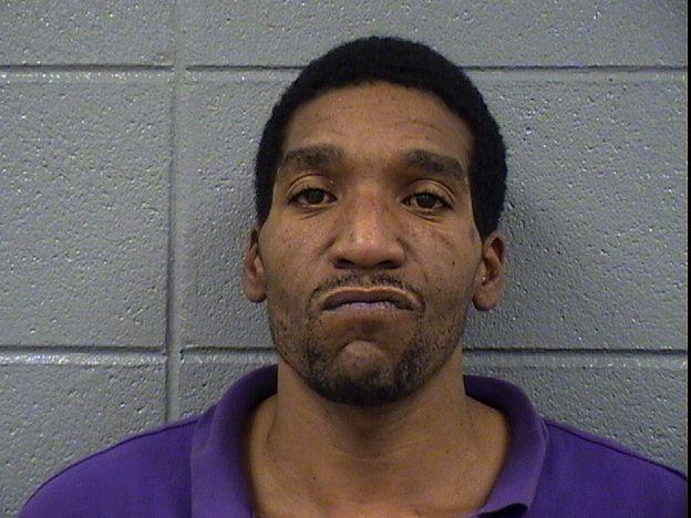 Derrick L. Davis, 33, wanted on suspicion of murder in Mobile, Ala., was arrested Tuesday in Chicago.